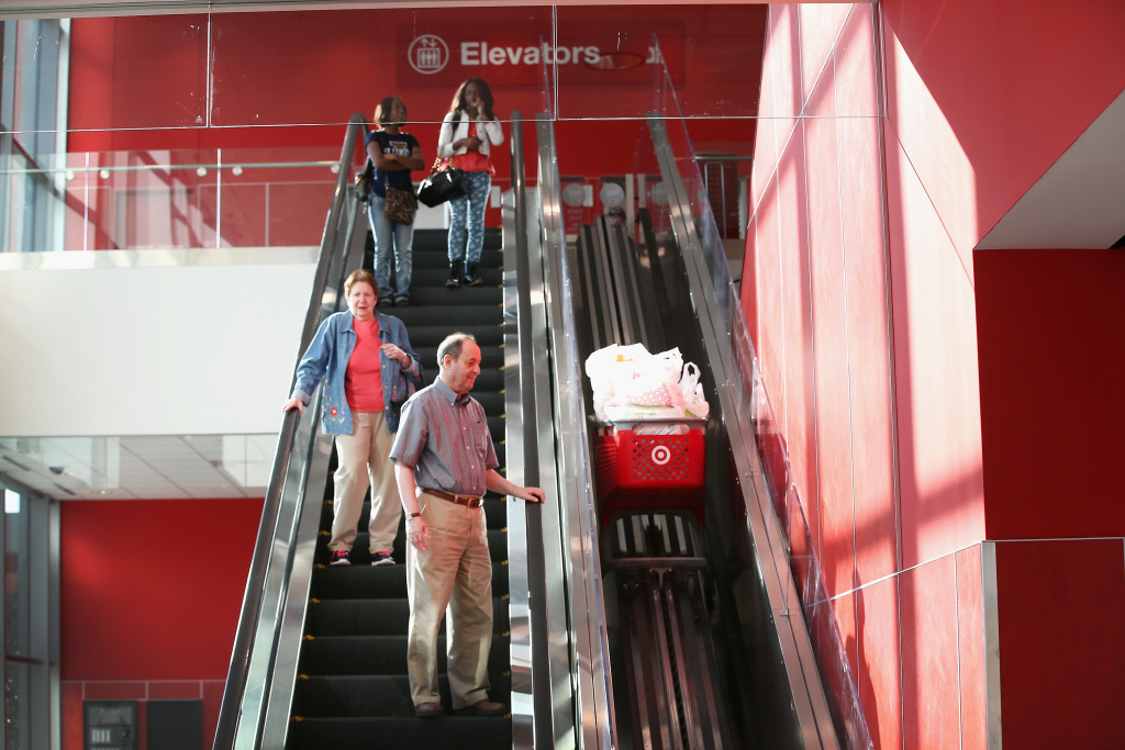 Customers leave a Target store with merchandise on October 10, 2013 in Chicago, Illinois.