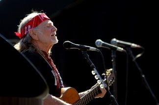 Willie Nelson performing prior to the NASCAR Sprint Cup Series AAA Texas 500 at Texas Motor Speedway on November 7, 2010 in Fort Worth, Texas.