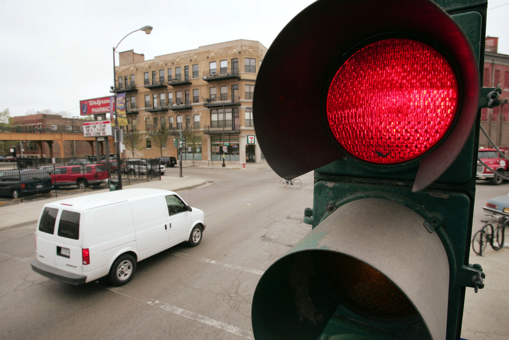 A traffic light controls the flow of vehicles and pedestrians April 20, 2005 near downtown Chicago, Illinois.
