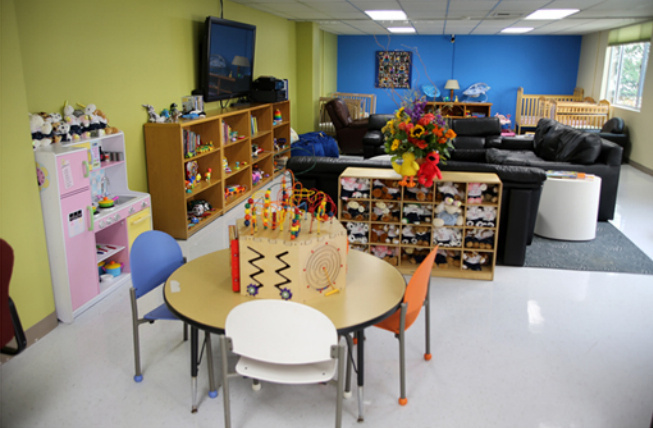 The living room area at the Children's Welcome Center operated by L.A. County's Department of Children and Family Services (DCFS). Small children wait here to be placed in foster homes