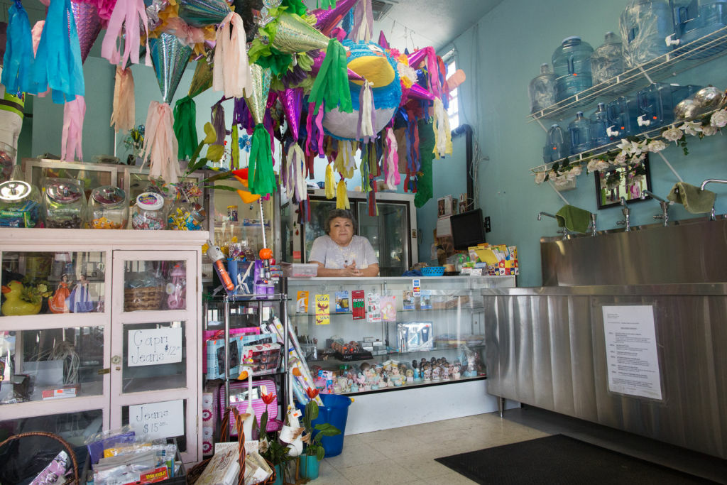 Lilia Perera and her husband own Agua Pura Vida, a store that sells water and gifts across the street from the site of the future Walmart. The couple worries that they won't be able to compete with Walmart's low prices.