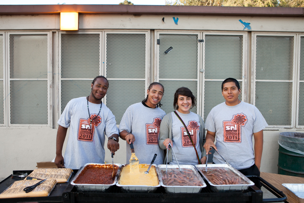 Summer Night Lights youth squad members serve up food at South Park.
