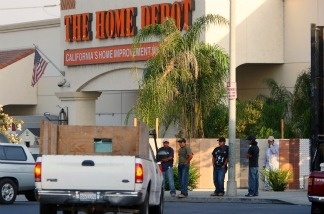 Day laborers wait near a Home Depot home improvement store in hope of finding work for the day on August 15, 2008 in Los Angeles, California.