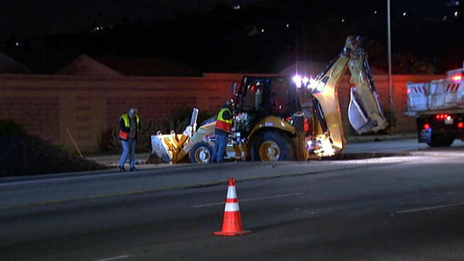 Road crews work on La Cienega Boulevard.