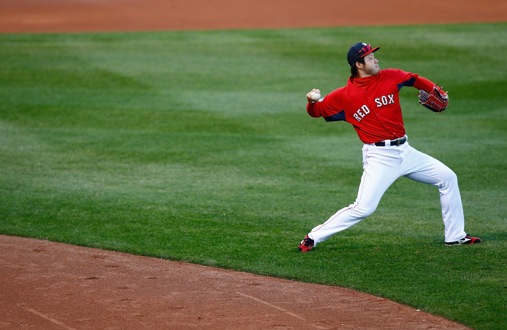 Junichi Tazawa #36 of the Boston Red Sox warms up during the team workout at Fenway Park on October 29, 2013 in Boston, Massachusetts.