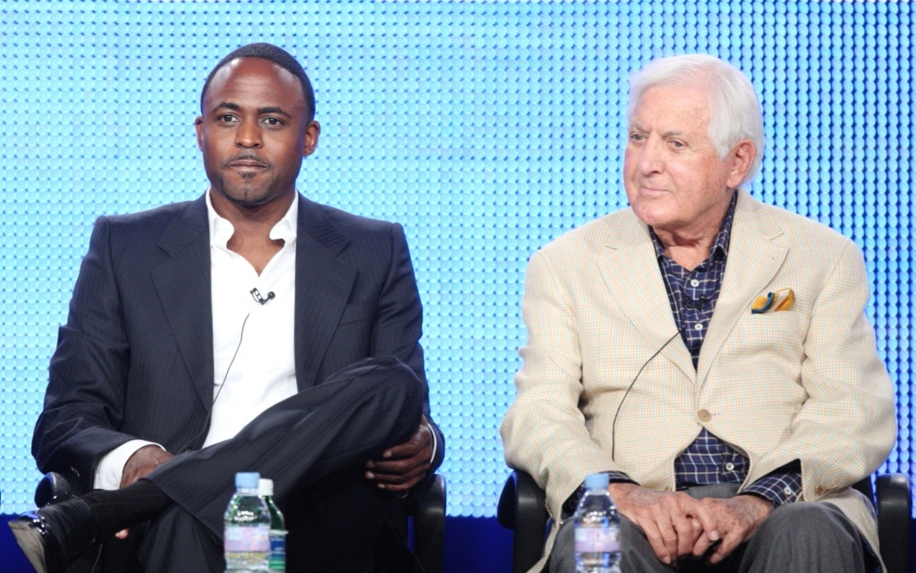 """Wayne Brady and Monty Hall of the television show """"Let's Make a Deal"""" listen during the 2009 Summer Television Critics Association Press Tour."""