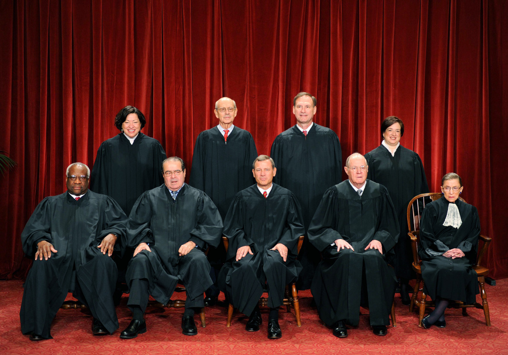 The Justices of the US Supreme Court sit for their official photograph on October 8, 2010 at the Supreme Court in Washington, DC. Front row (L-R): Associate Justice Clarence Thomas,  Associate Justice Antonin Scalia, Chief Justice John G. Roberts, Associate Justice Anthony M. Kennedy and Associate Justice Ruth Bader Ginsburg. Back Row (L-R): Associate Justice Sonia Sotomayor, Associate Justice Stephen Breyer, Associate Justice Samuel Alito Jr. and Associate Justice Elena Kagan.