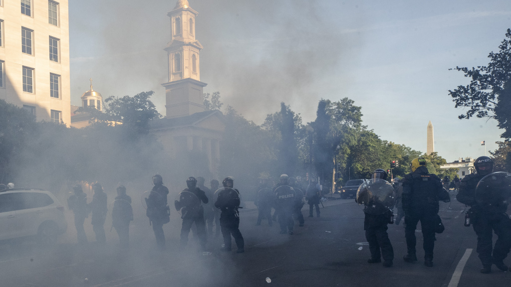 On Monday, police move demonstrators away from  Lafayette Park, across from the White House.