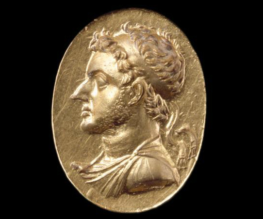 A portrait in gold of a Ptolemy on a ring. The disc is 3/4