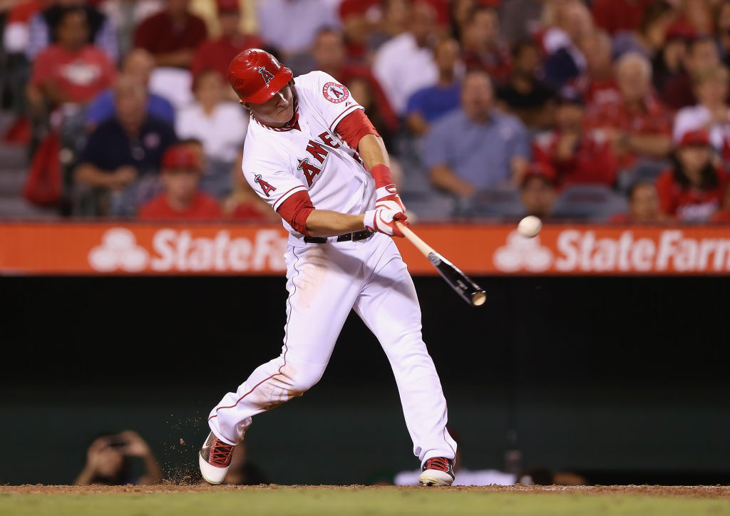 Mike Trout #27 of the Los Angeles Angels of Anaheim hits a base hit against the Seattle Mariners in the third inning at Angel Stadium of Anaheim on Sept. 25, 2012 in Anaheim.