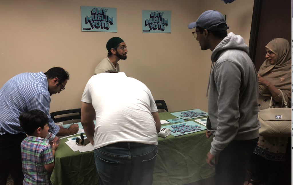 MPower Change organizing director Ishraq Ali registers voters at the Middle Ground Muslim Center in Upland, California.