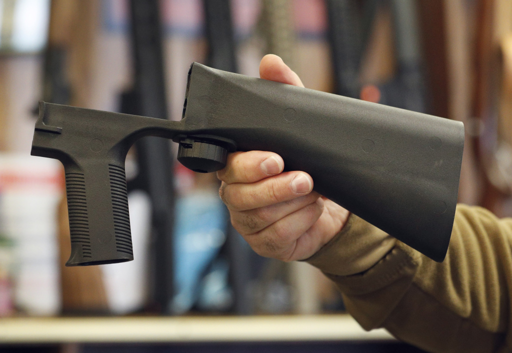 A bump stock device that fits on a semi-automatic rifle to increase the firing speed, making it similar to a fully automatic rifle, is shown here at a gun store on October 5, 2017 in Salt Lake City, Utah.