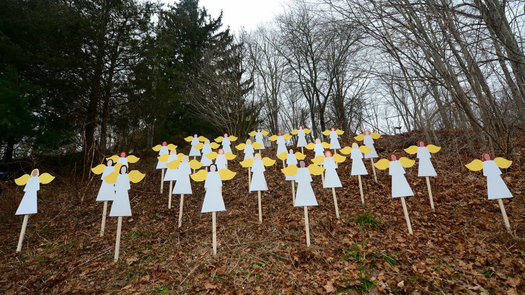 Wooden angels memorialize the victims of Adam Lanza's shooting spree in Newtown, Conn., last December.