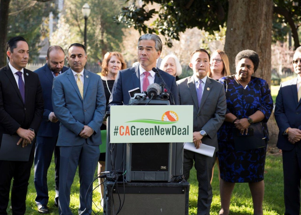 Assemblyman Rob Bonta announces the California Green New Deal Act with other lawmakers near the the Capitol in downtown Sacramento, Monday, Jan. 6, 2019.