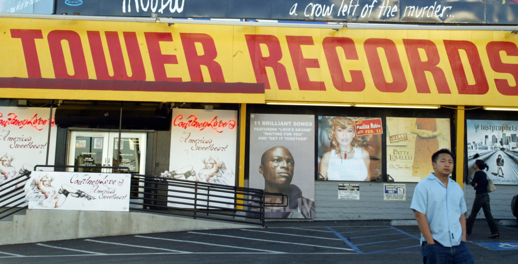 A patron leaves the Tower Records store in West Hollywood, California, February 6, 2004.