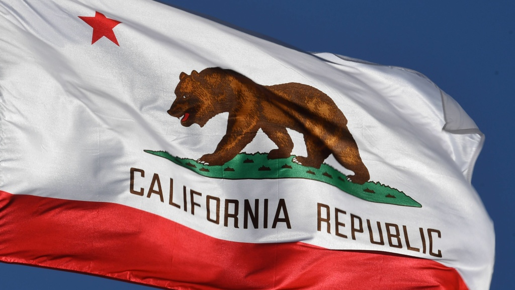 The California state flag flies outside City Hall in Los Angeles. A bid to ask voters if they want to split California into three separate states has been stymied by the state Supreme Court.