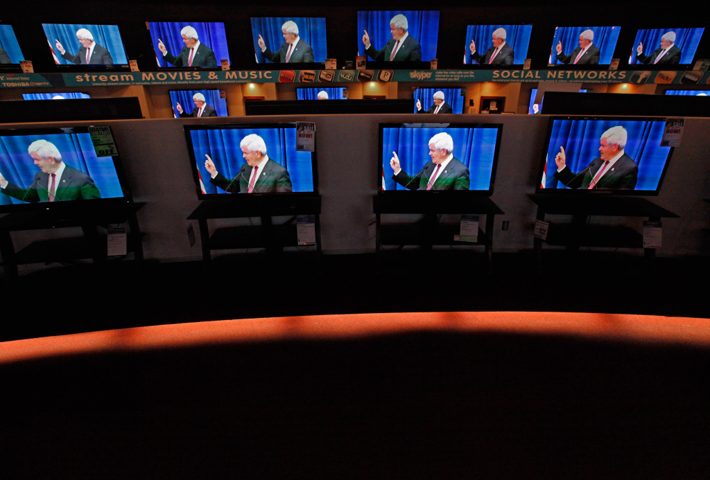 Dozens of televisions display a political advertisement with the image of former Speaker of the House Newt Gingrich. Super PACs have spent millions on television ads attacking Mitt Romney ahead of the South Carolina primary.
