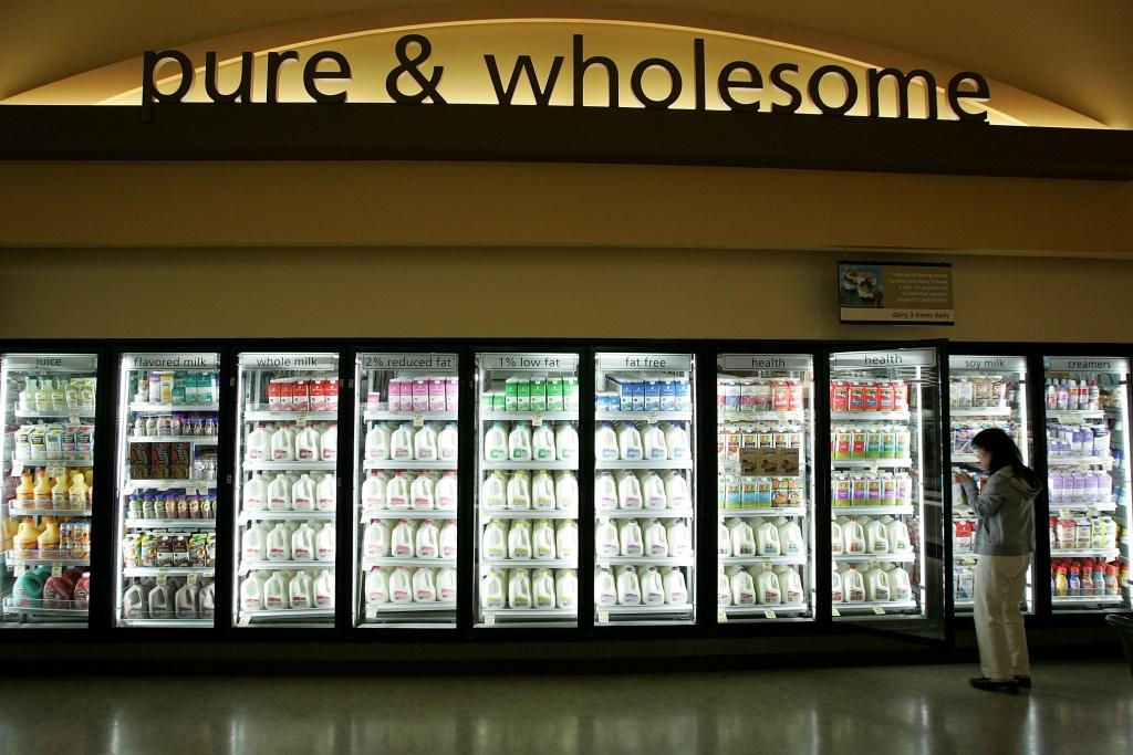 A Safeway customer shops for milk at Safeway's new