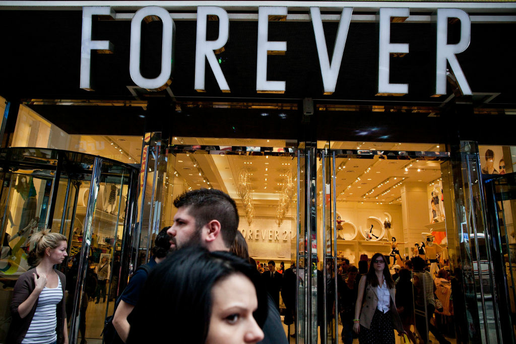 People walk past a Forever 21 store in Times Square on March 23, 2012 in New York City.