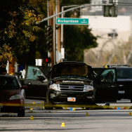 FBI agents and local law enforcement examine the crime scene where suspects of the Inland Regional Center were killed on December 3, 2015 in San Bernardino, California.