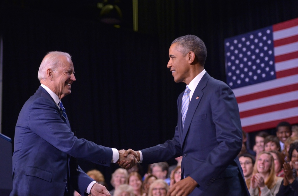 Vice-President Joe Biden shakes hands with President Barack Obama Friday after introducing him at Pellissippi State Community College in Knoxville, Tennessee, where Obama promoted his college plan.
