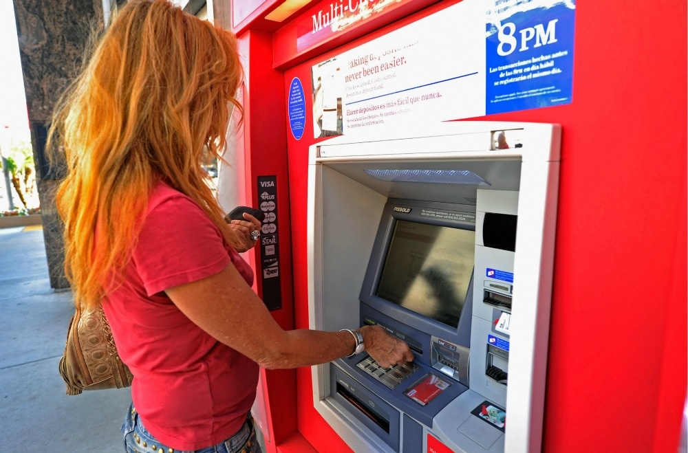 Bank of America is preparing to charge $5 a month for debit card users starting early next year.