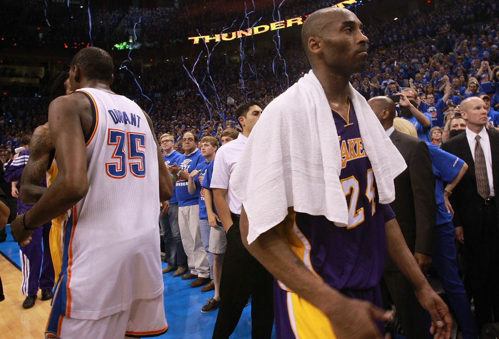 Kobe Bryant, #24, of the Los Angeles Lakers walks past Kevin Durant, #35, of the Oklahoma City Thunder after a 106-90 loss during Game Five of the Western Conference Semifinals of the 2012 NBA Playoffs.