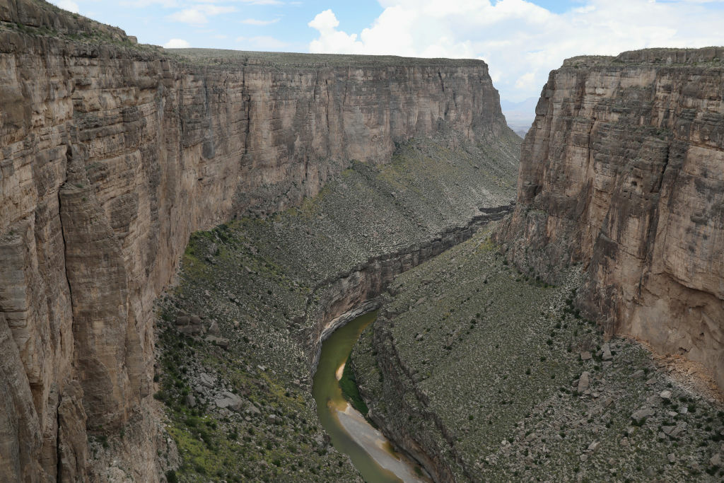 The Rio Grande forms the U.S.-Mexico border while winding through the Santa Elena Canyon in the Big Bend region near Lajitas, Texas. Logistical challenges, such as the terrain of Big Bend in west Texas, are just some of the complications facing the construction of a border wall proposed by President Trump.