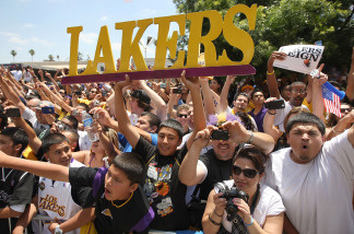 Fans cheer for the Los Angeles Lakers during their victory parade for the the NBA basketball champion team on June 21, 2010 in Los Angeles, California.