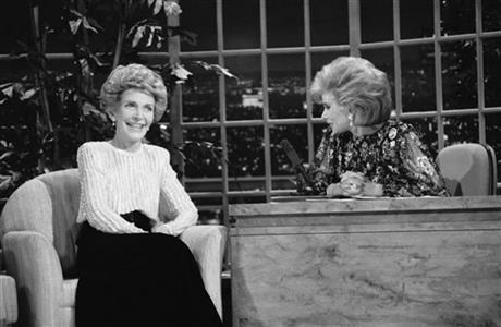 In this Oct. 30, 1986 file photo, talk show host Joan Rivers, right, talks with guest, first lady Nancy Reagan, during her appearance on
