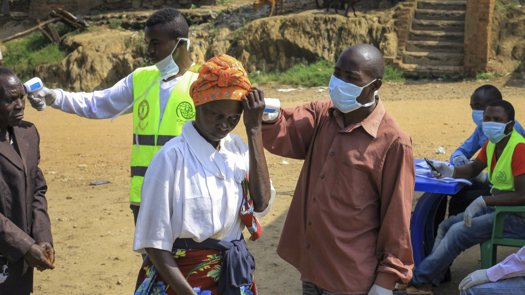 People crossing the border have their temperature taken to check for symptoms of Ebola, near Kasindi, eastern Congo on Wednesday.