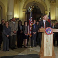 Colorado Gov. John Hickenlooper speaks at a news conference at the Capitol in Denver on Wednesday.