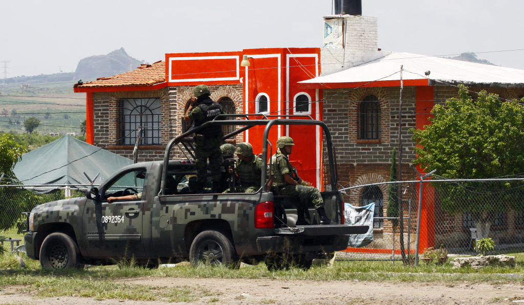 Members of the Army patrol the surroundings of the Puente Grande State prison in Zapotlanejo, Jalisco State, Mexico, on Aug. 9, 2013 where former top Mexican cartel boss Rafael Caro Quintero was being held.