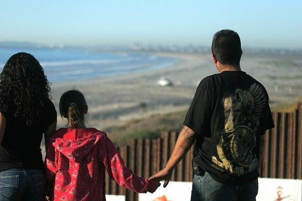 A family looks north into the United States from Playas de Tijuana, January 2009