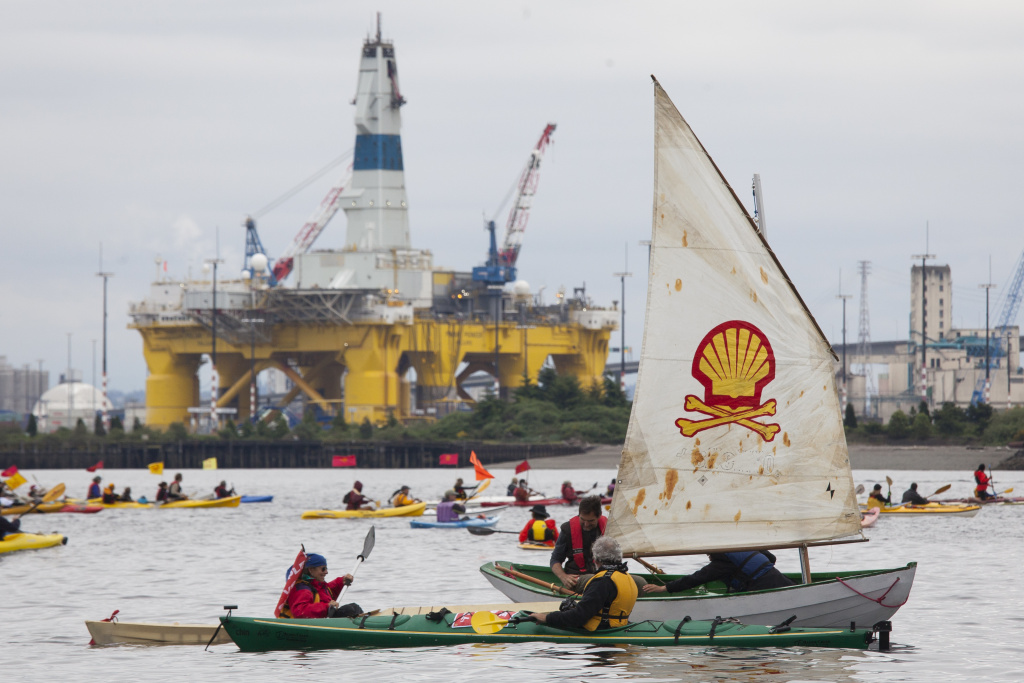 ShellNo flotilla participants float near the Polar Pioneer oil drilling rig during demonstrations against Royal Dutch Shell on May 16, 2015 in Seattle, Washington. Demonstrators began three days of protests both on land and on Puget Sound over the presence of the first of two Royal Dutch Shell oil rigs in the Port of Seattle