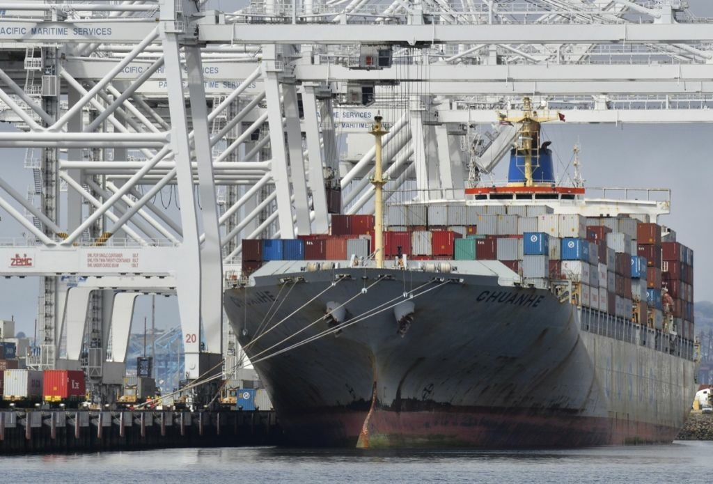 A cargo ship stands on Long Beach harbor, California, in 2012.
