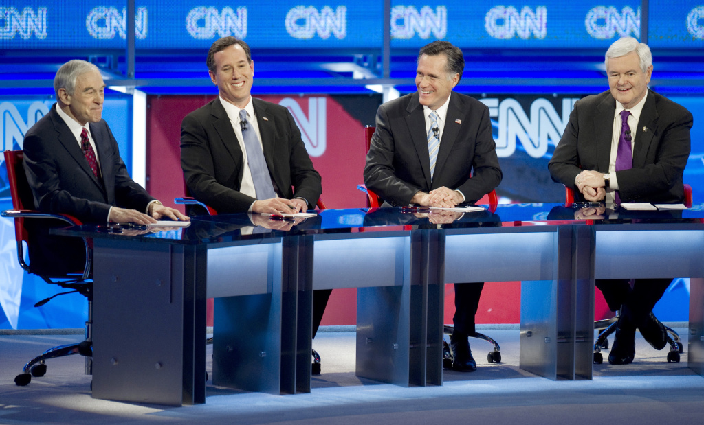 Republican presidential candidates Ron Paul (L), Rick Santorum (2nd L), Mitt Romney (2nd R) and Newt Gingrich during a February debate.