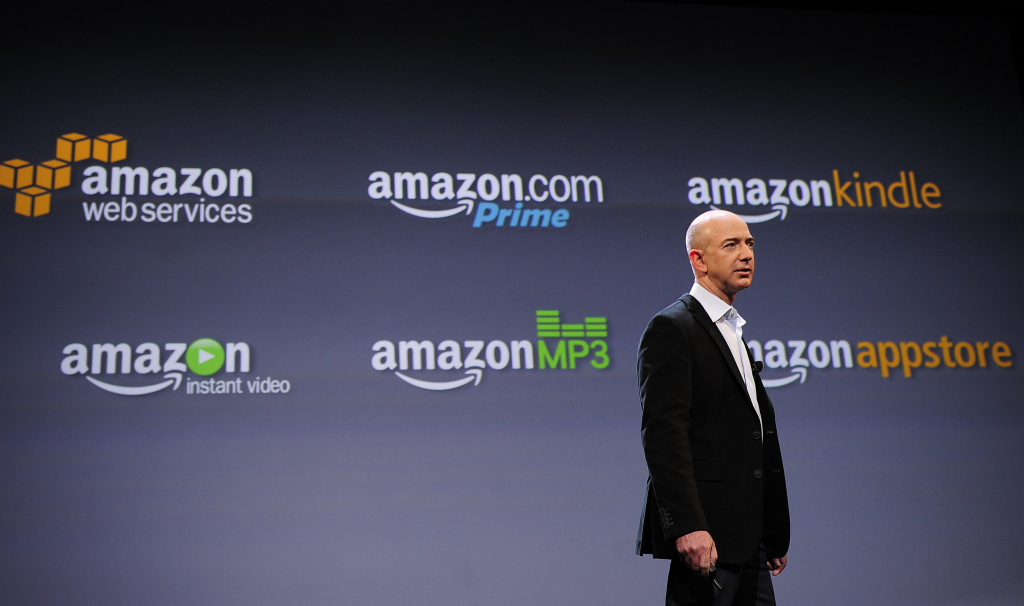 Amazon CEO Jeff Bezos addresses a press conference. The online mega-retailer will start charging California customers sales tax.