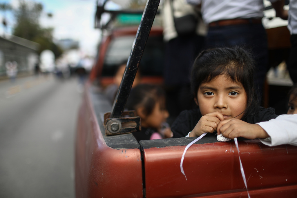 A girl rides in a truck during a march for peace near the U.S./Mexico border on March 11, 2018 in Tijuana, Mexico.