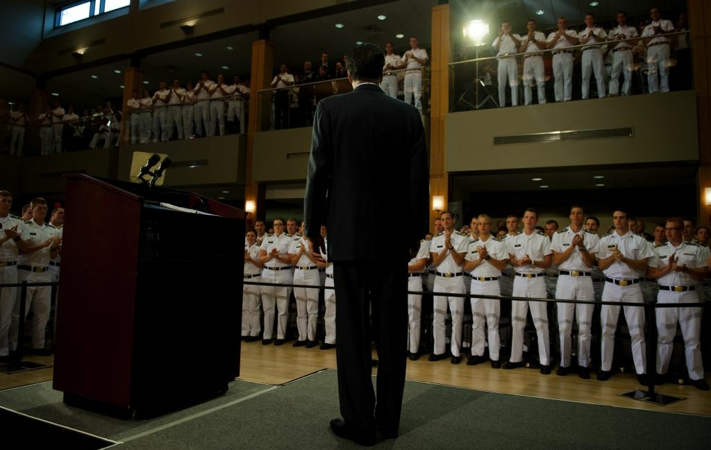 US Republican presidential candidate Mitt Romney (C) stands for applause as he arrives to deliver a foreign policy speech at the Virginia Military Institute in Lexington, Virginia, on October 8, 2012.