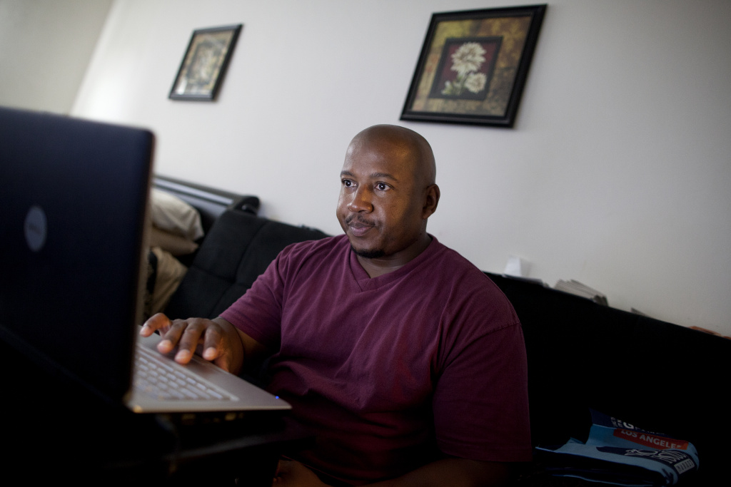 In between Delvon Brown's part-time job delivering drinking water, he searches the Internet for full-time driving jobs.