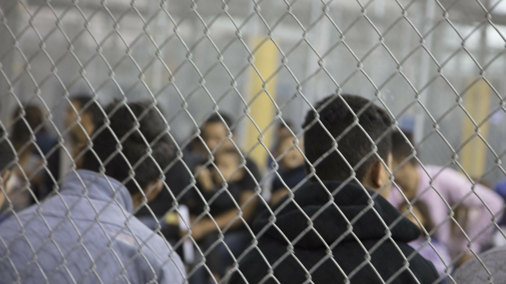 U.S. Border Patrol agents conduct intake at the Central Processing Center in McAllen, Texas. The center is temporarily not taking in migrants after the outbreak of