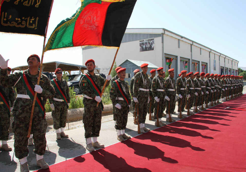 Afghan Army soldiers stand during a security transition ceremony in Mazar-e-Sharif, north of Kabul, Afghanistan, on July 23, 2011.