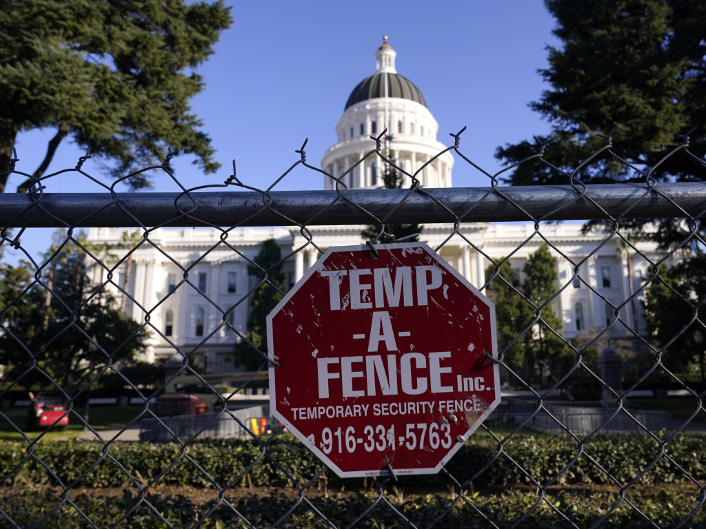 A temporary 6-foot-high chain-link fence now surrounds California's state Capitol. Gov. Gavin Newsom said Thursday,