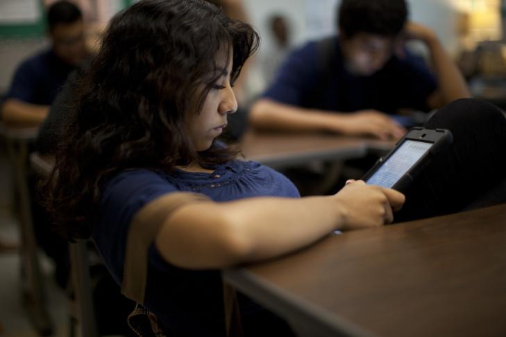 Jackueline Arreola, 16, reads YA novel,