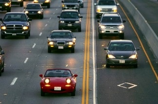 Cars drive in the high-occupancy vehicle lane near Simi Valley, California.