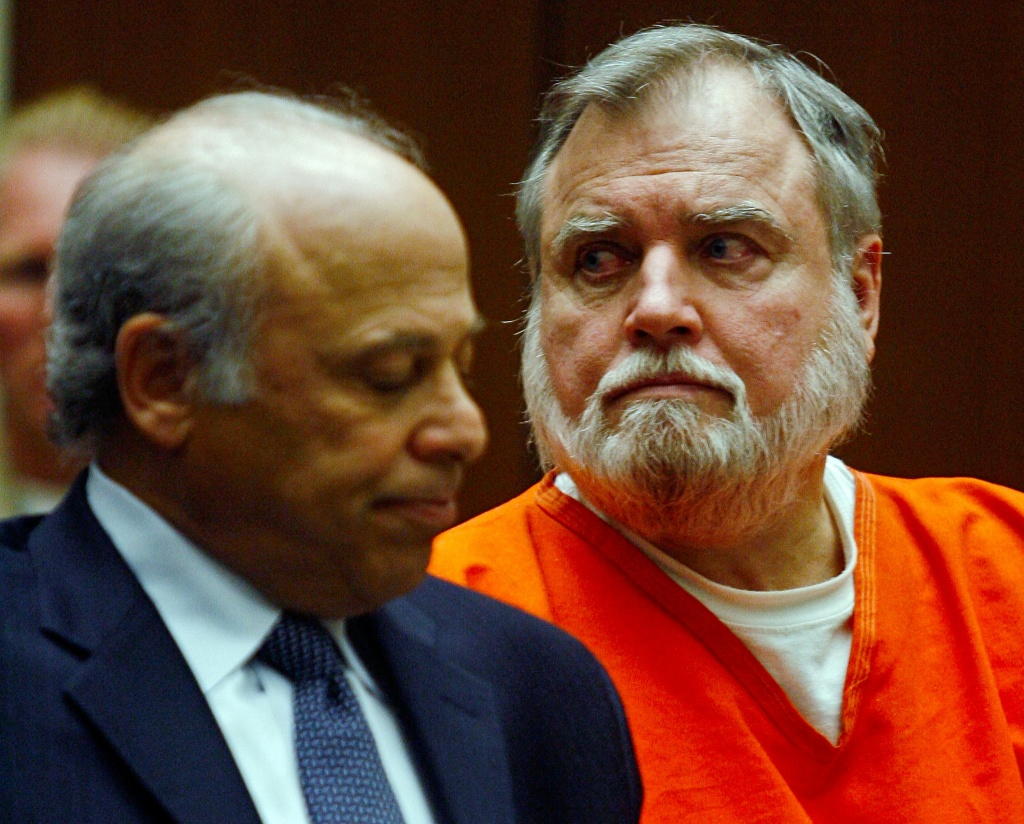 Michael Stephen Baker, right, a former Catholic priest accused of molesting a number of boys over the past 20 years pleads guilty to sexually abusing two boys listens to his victim's testimony Monday, Dec. 3, 2007, after being sentenced to 10 years in prison during a court appearance in Los Angeles Superior Court. At left is his attorney, Leonard Levine.