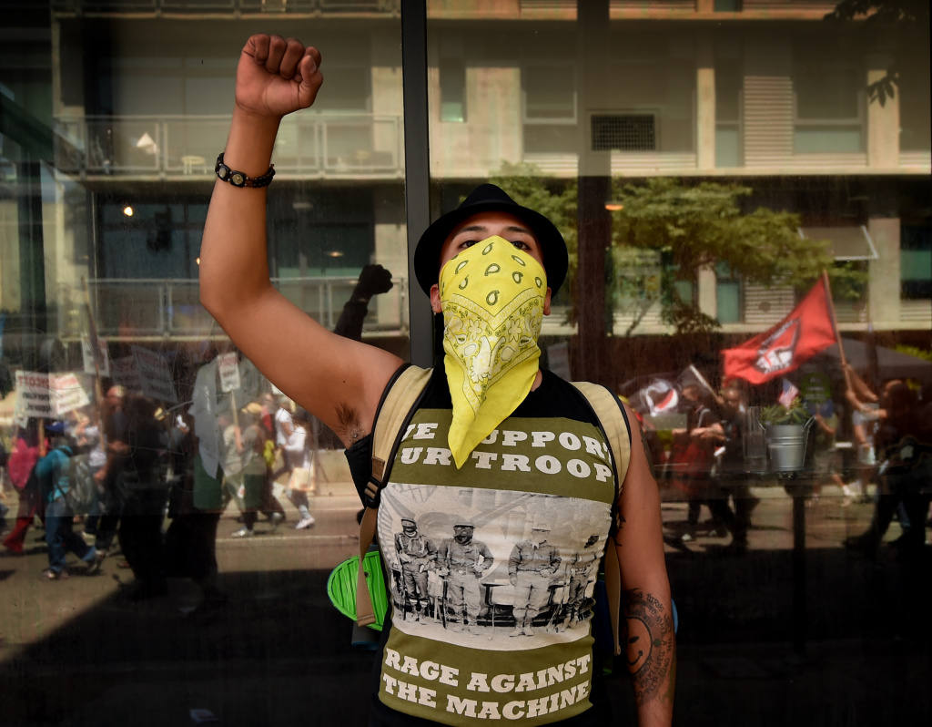 A man shows his support for immigration rights protesters during a May Day rally march to the Immigration and Customs Enforcement (ICE) detention center in Los Angeles, California on May 1, 2016. / AFP / Mark Ralston        (Photo credit should read MARK RALSTON/AFP/Getty Images)