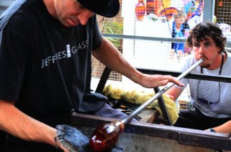 Christopher Jeffries, left, shapes a glass mug as his assistant Cameron Dougherty blows through the pipe to give the piece its final form at the Sawdust Art Festival on July 25, 2010 in Laguna Beach, Calif.