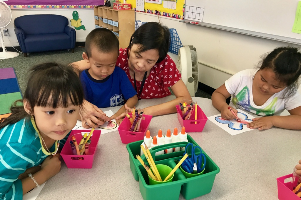 Teacher Van Vu helps transitional kindergarten students at Murdy Elementary School in Garden Grove School District. Vu teaches the Vietnamese half of the school's new dual language immersion program, Sept. 13, 2017.